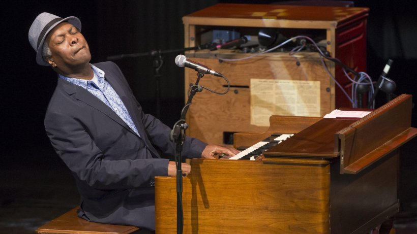 Booker T. Jones plays an organ with a Leslie speaker.