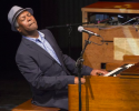 Booker T. Jones plays an organ with Leslie speaker.