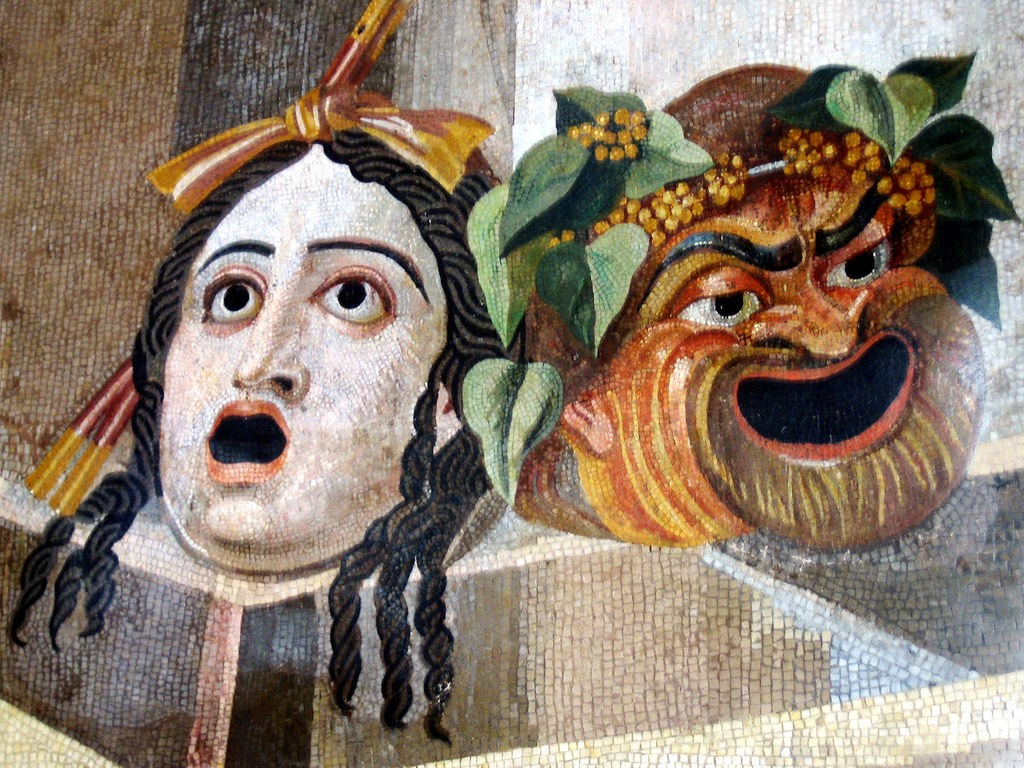 Roman mosaic, 2nd century CE, showing theatrical masks of comedy and tragedy, from the Baths of Decius on the Aventine Hill, Rome. [image by antmoose, CC BY 2.0 (http://creativecommons.org/licenses/by/2.0)], via Wikimedia Commons