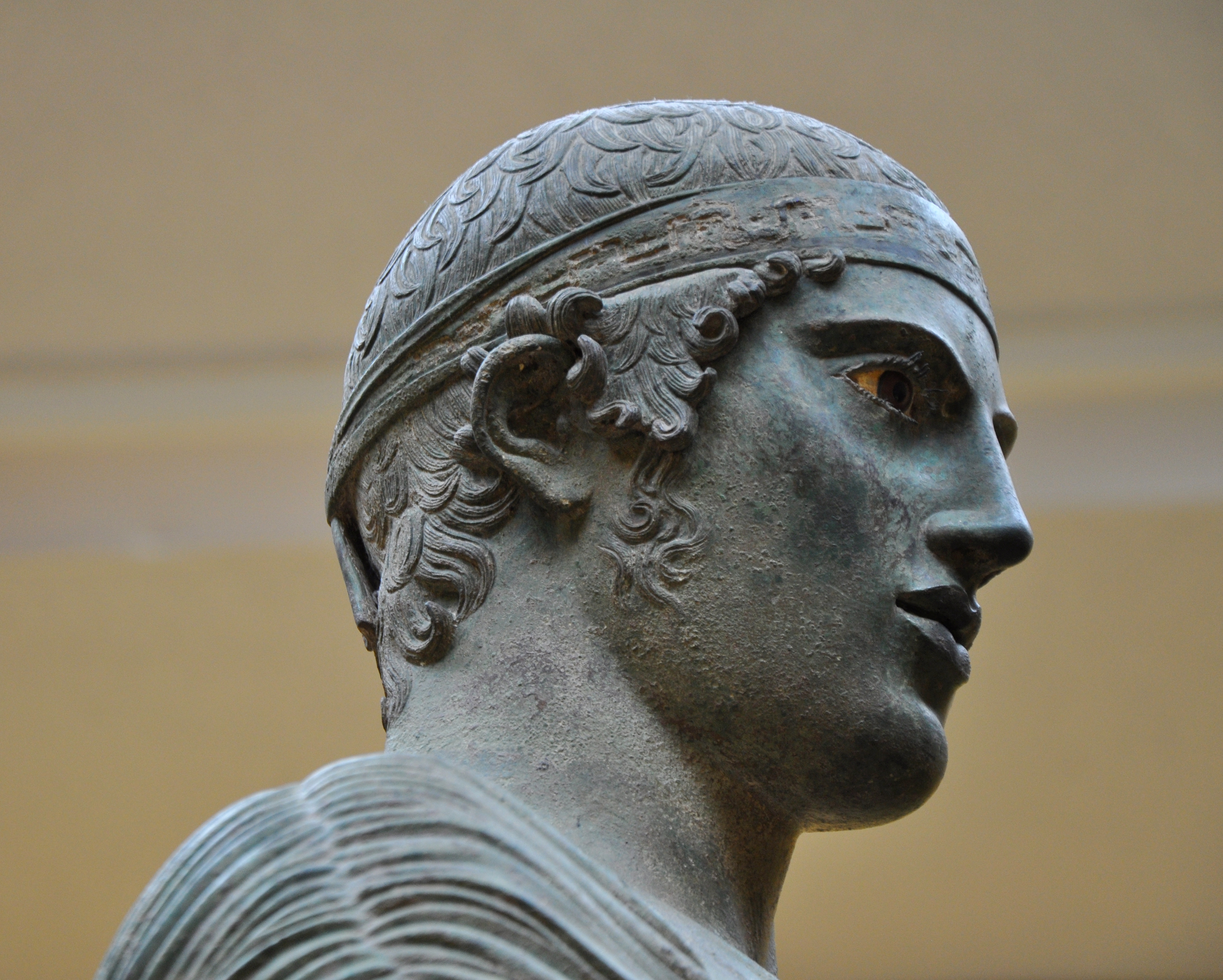 """Closeup of the """"Charioteer of Delphi."""" Greek bronze, circa 470s B.C.E. Image by Helen Simonsson (Own work) [CC BY-SA 3.0 (http://creativecommons.org/licenses/by-sa/3.0)], via Wikimedia Commons."""