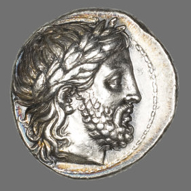 "Greek, minted in Pella, Macedon Tetradrachm (Coin) Depicting the God Zeus, Reign of Phillip II (359–336 B.C.) Silver Diam. 2.6 cm; 14.47 g REV: ΦΙΛΙΠΠΟΥ ""(minted by) Philip"" Gift of Martin A. Ryerson, 1922.4923"
