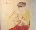 A Muse playing a lyre. Detail from Greek vase housed at Staatliche Antikensammlungen, 440–430 BCE. Photo by Bibi Saint-Pol (own work, 2007-02-10) [Public domain], via Wikimedia Commons.