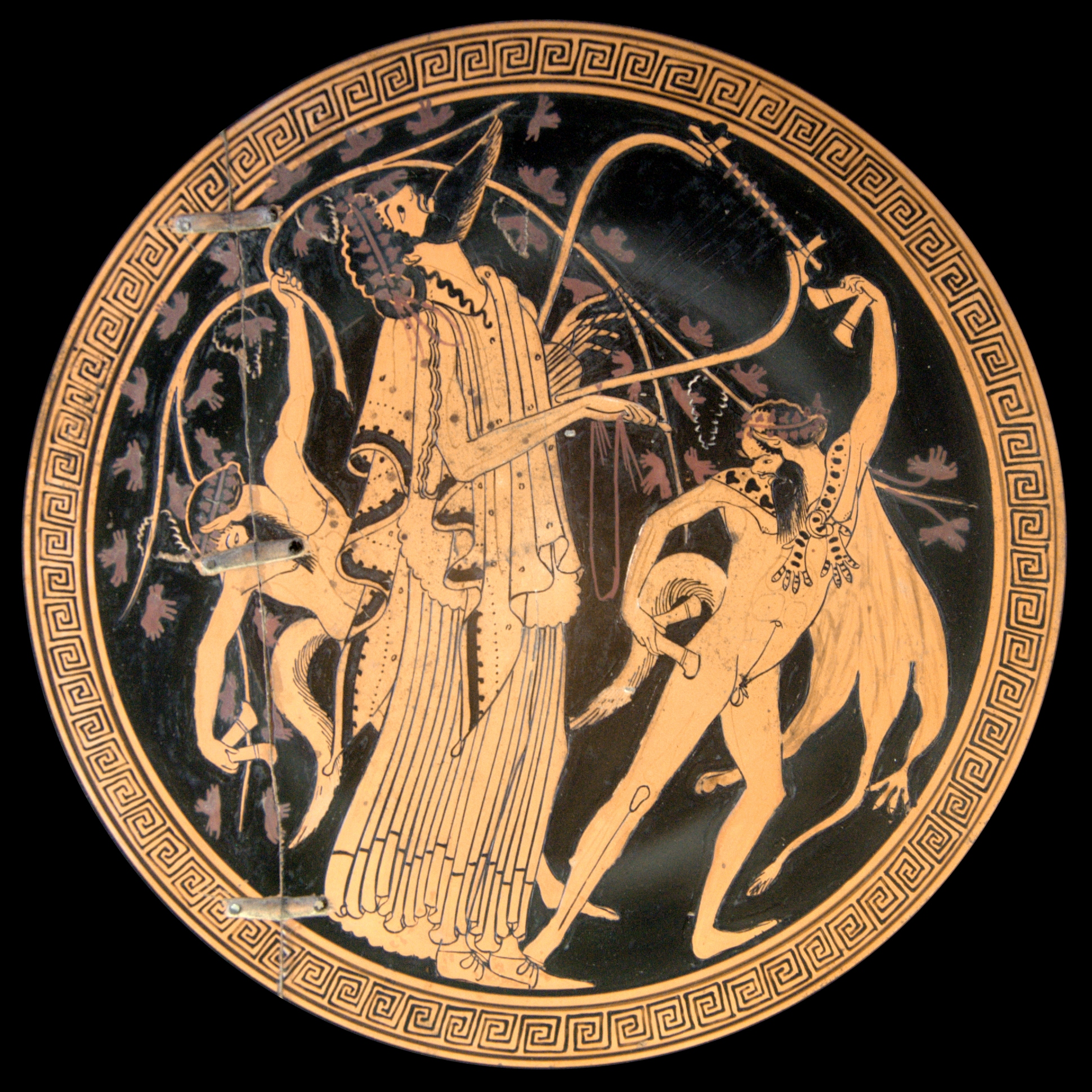 Dionysos and sileni. Attic red-figured cup interior, circa 480 BCE. Photo by Bibi Saint-Pol, own work, 2007-05-25) [Public domain], via Wikimedia Commons.