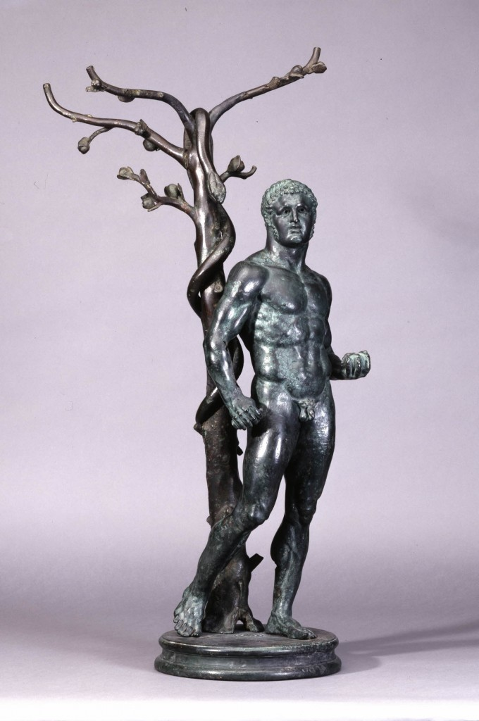 Herakles at the tree of the Hesperides, holding three of the golden apples in his left hand. Behind him is the apple tree with the guardian serpent clinging around it.Bronze, 104.5cm (Roman, 1st century C.E.).Image via The British Museum.